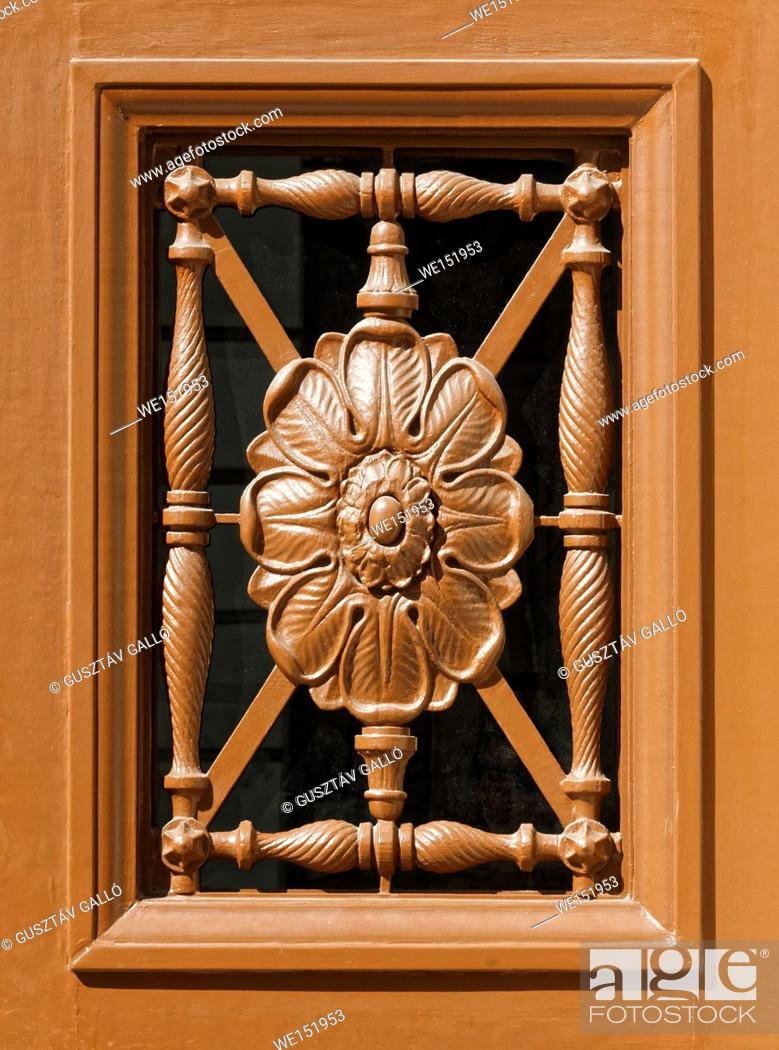Stock Photo: Carved wooden floral pattern decorative door window.