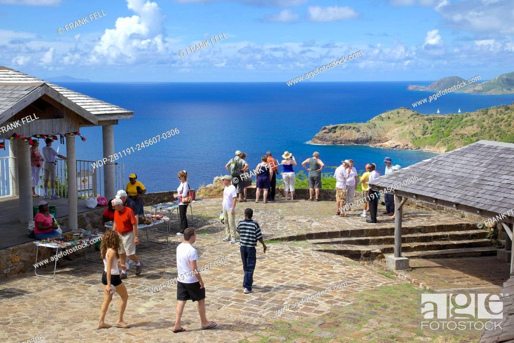 Stock Photo: West Indies, Caribbean, Antigua, View from Shirley Heights & Tourists.