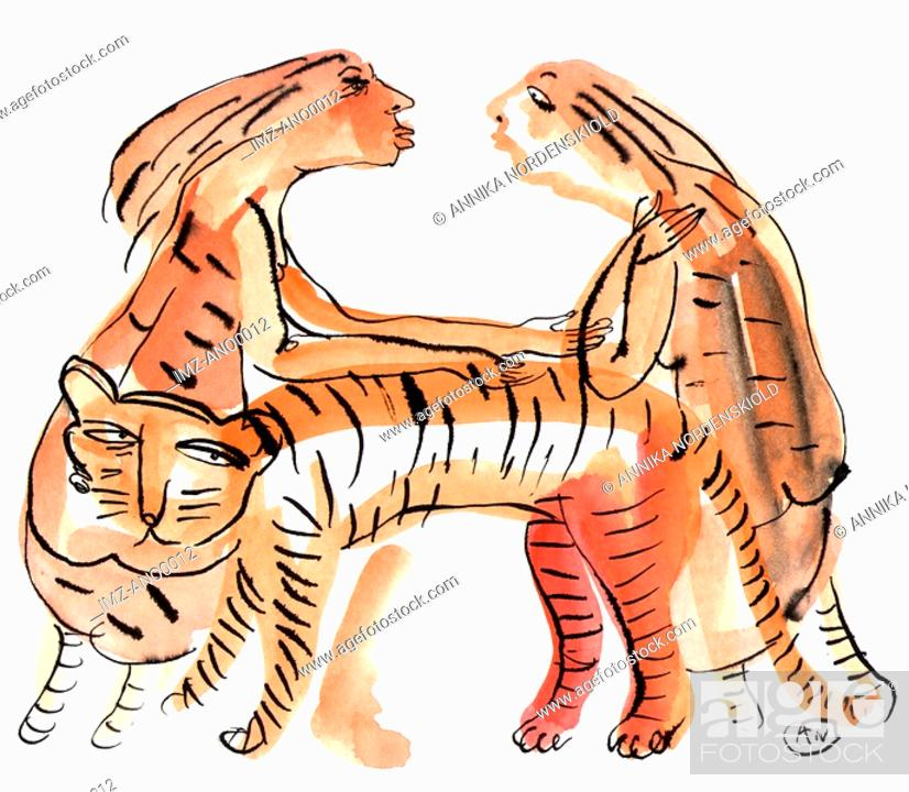 Stock Photo: Two women with girl power are able to tame a tiger.
