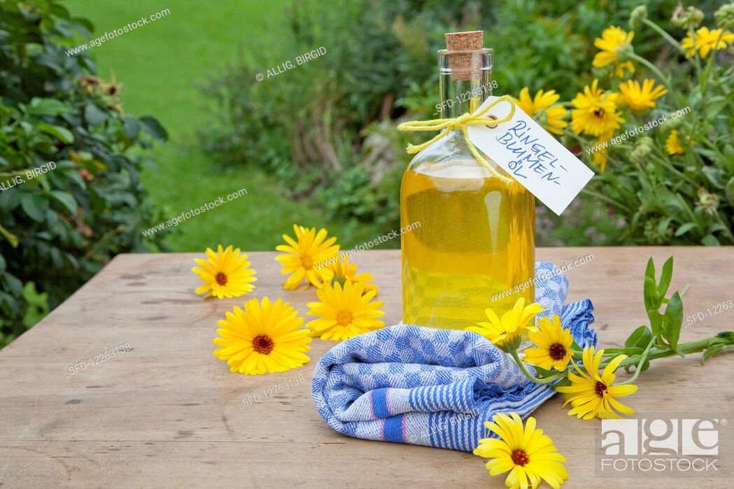 Stock Photo: Homemade marigold oil in a bottle for gifting.