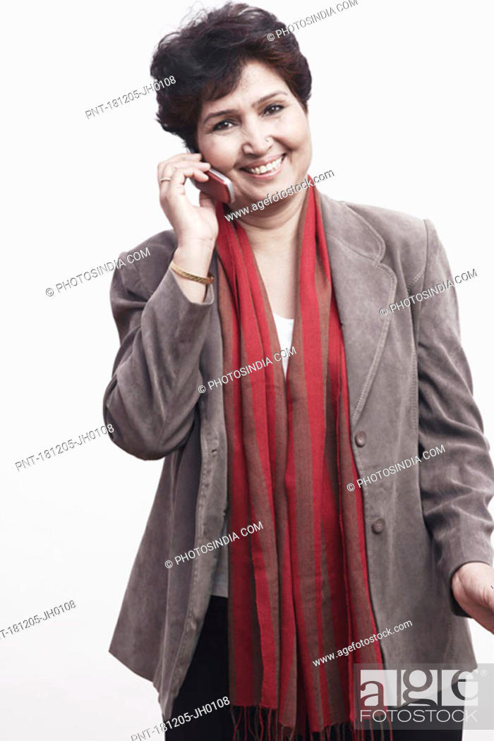 Stock Photo: Portrait of a mature woman talking on a mobile phone.