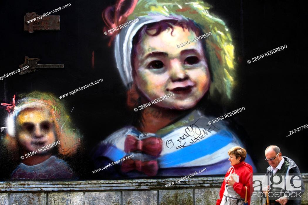 Stock Photo: Graffiti painted on the Galiana street in the center of Aviles, Asturias, Spain. One of the stops of the Transcantabrico Gran Lujo luxury train.