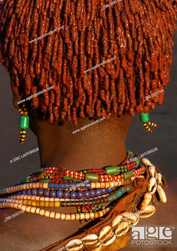 Stock Photo: Ethiopia, Omo Valley, Turmi, close up of the back head of a hamer tribe girl.