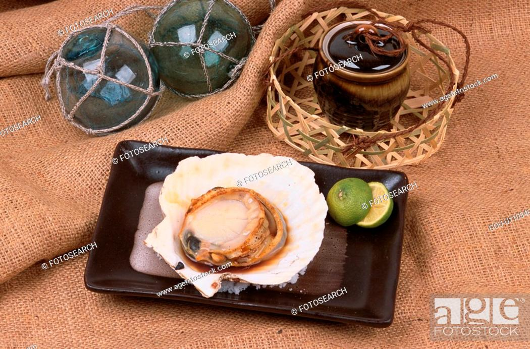 Stock Photo: Scallop With Shell On Plate.