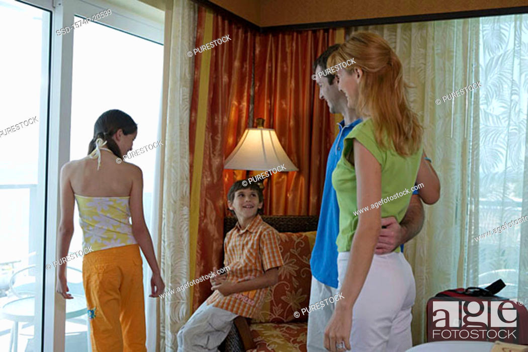 Stock Photo: Young couple with their son and daughter in a hotel room.