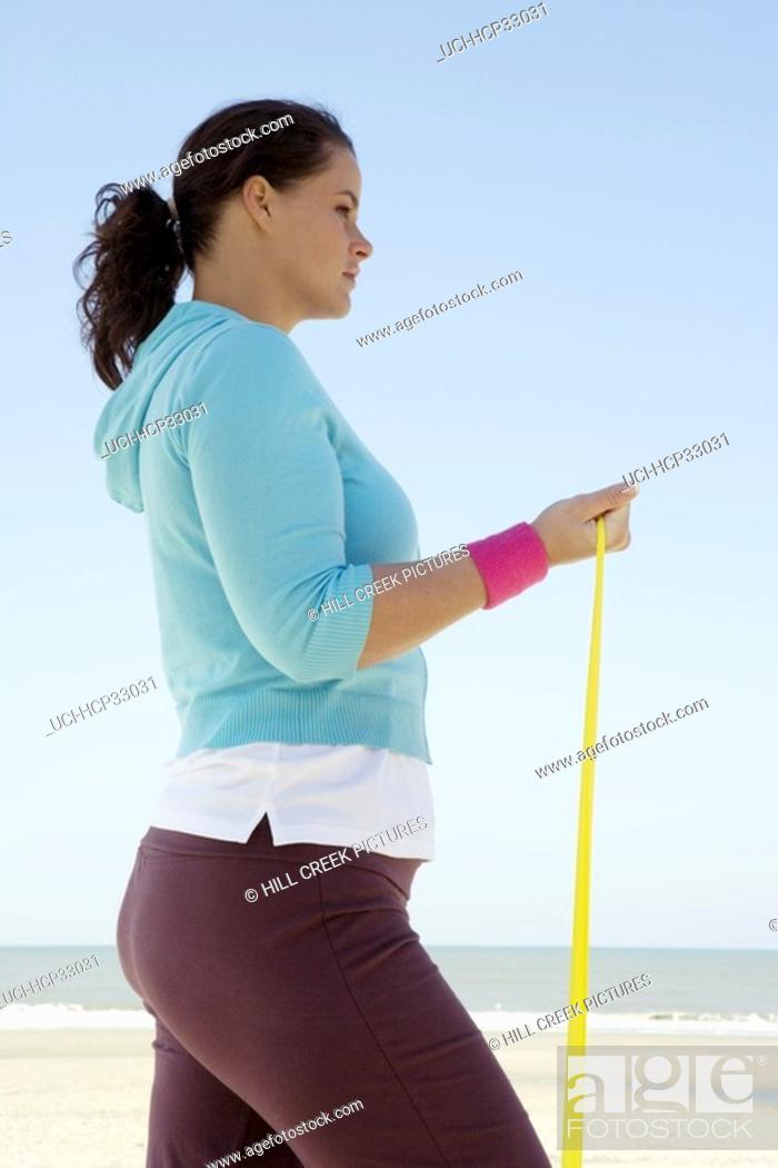 Stock Photo: Woman exercising at beach.