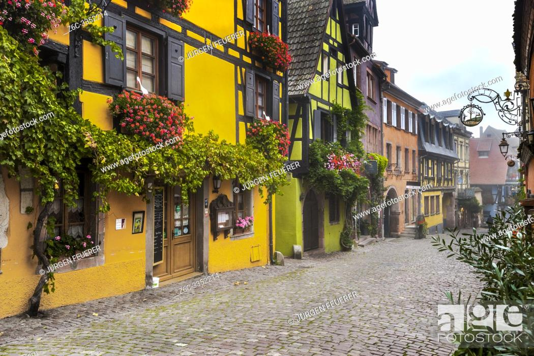 Stock Photo: colorful houses in the village Riquewihr, Alsace Wine Route, France, vine and flower-bedecked half-timbered houses.