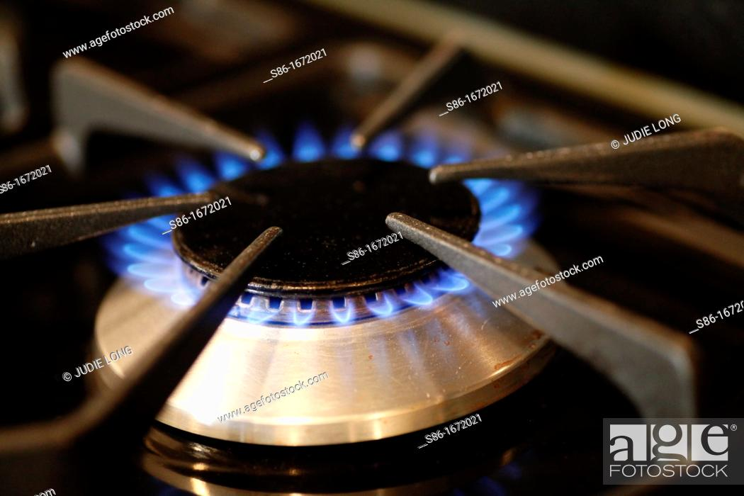 Stock Photo: Open Gas Flame on a Cooking Stove.