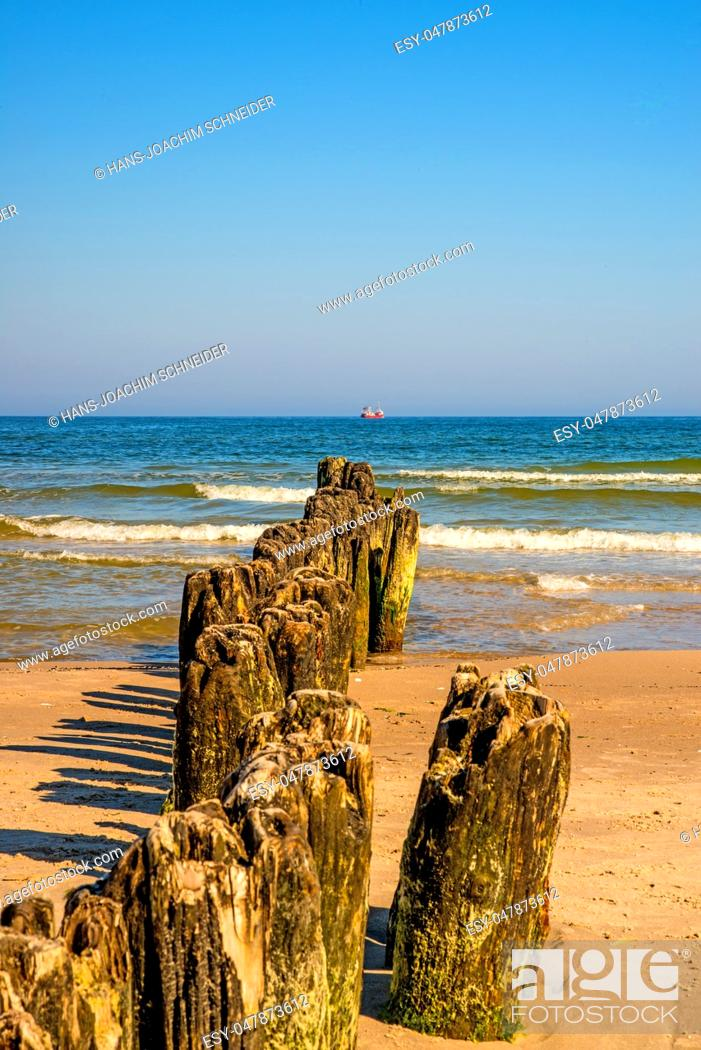 Stock Photo: old groins in the Baltic Sea with blue sky.