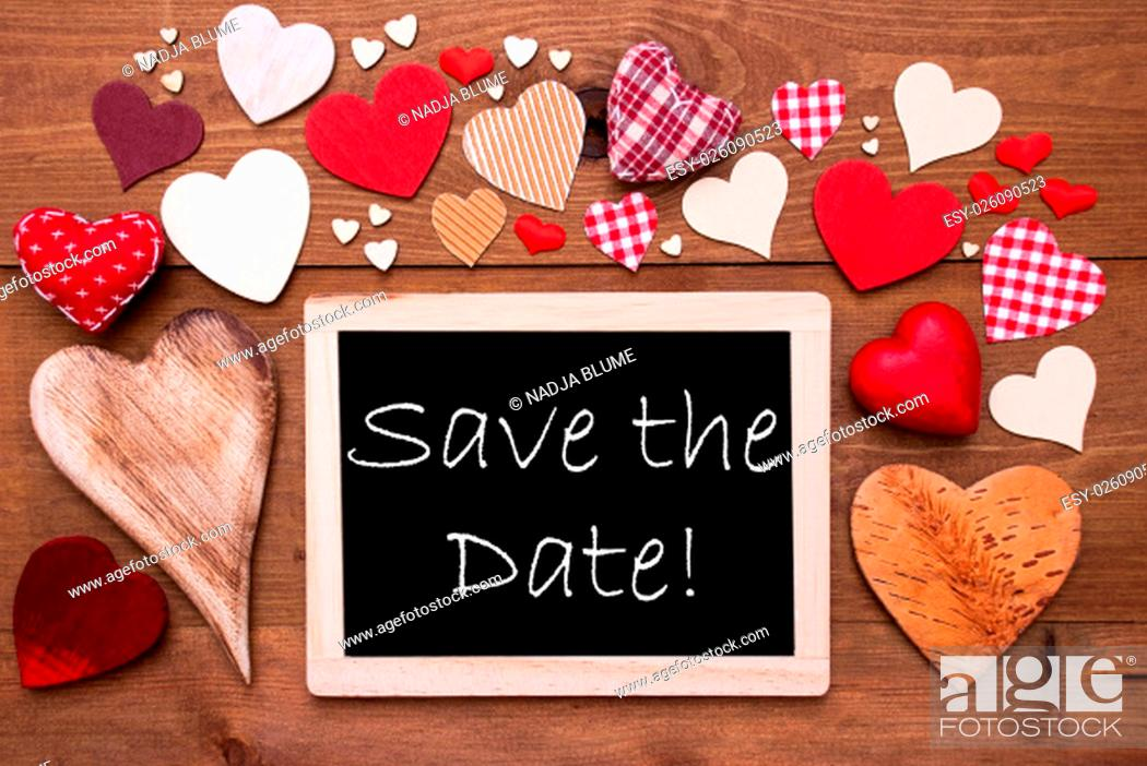 Stock Photo: Chalkboard With English Text Save The Date. Many Red Textile Hearts. Wooden Background With Vintage, Rustic Or Retro Style.
