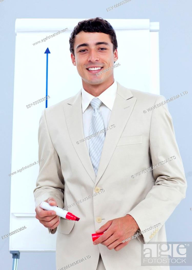 Stock Photo: Charming businessman giving a presentation in a company.