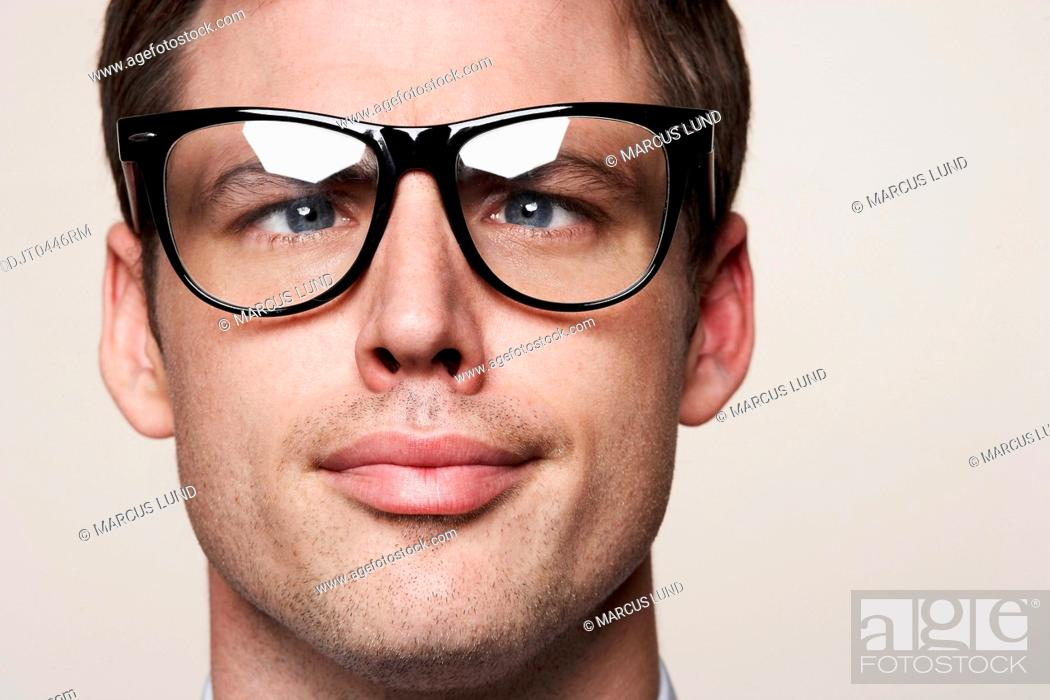 Stock Photo: Young man wearing retro glasses.