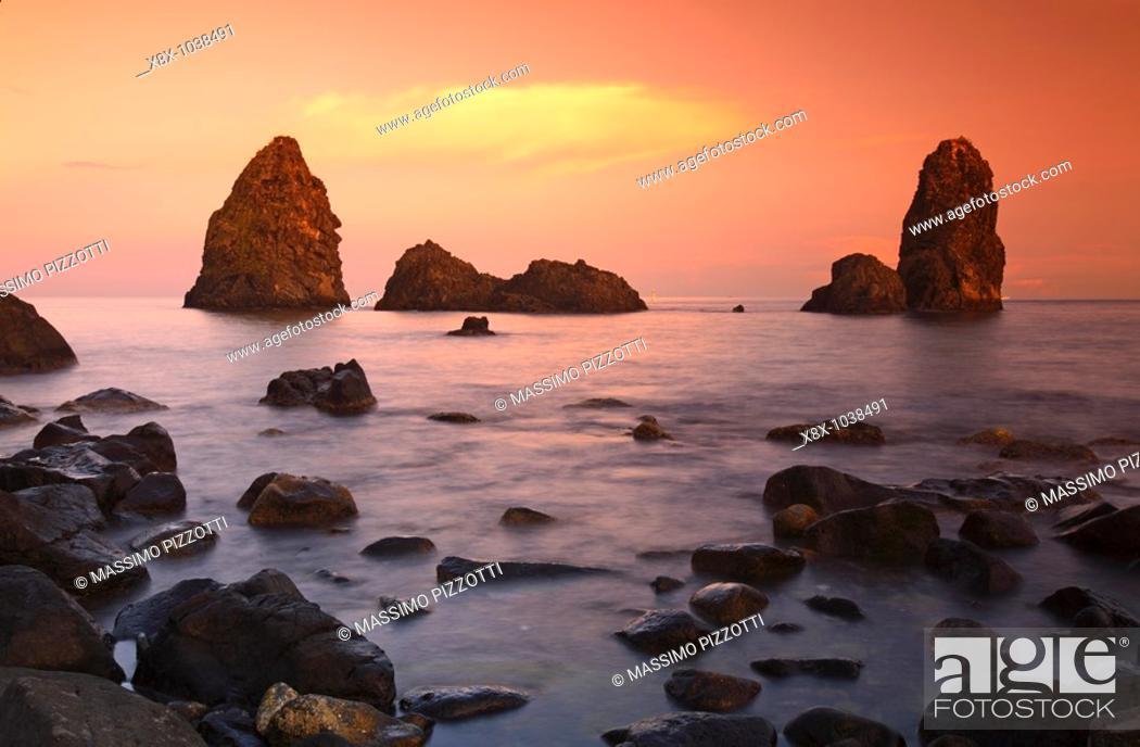 Stock Photo: Cyclops stacks in Aci Trezza, Sicily, Italy.