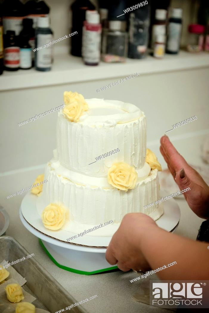 Stock Photo: Woman preparing cake in kitchen.