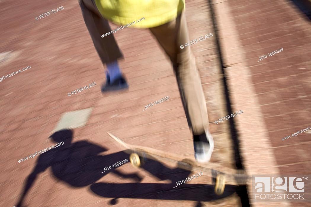 Stock Photo: Close-up of a preteen boy skateboarding.