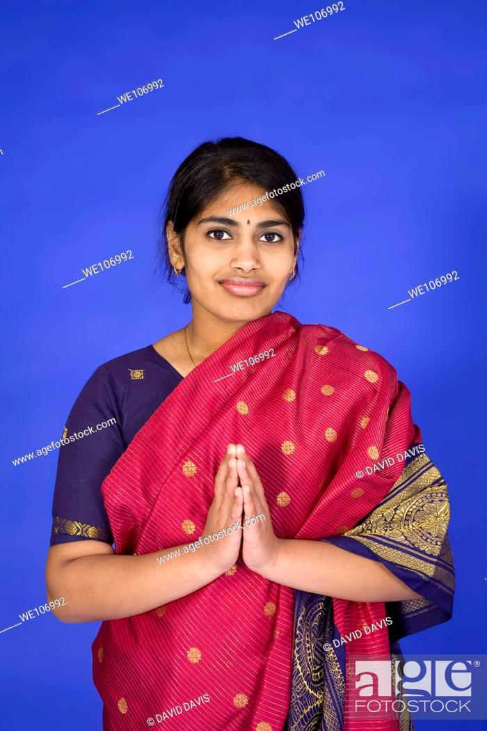 Stock Photo: Beautiful Hindu teenager dressed in a traditional Sari dress.