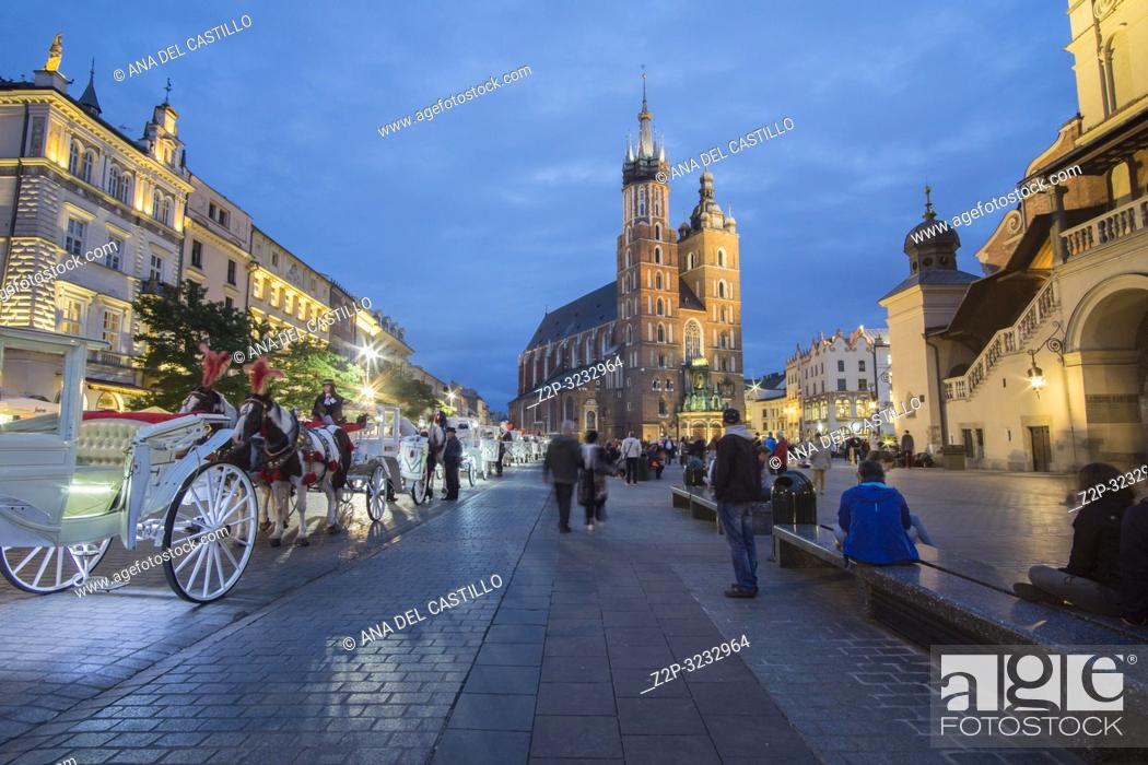 Stock Photo: KRAKOW POLAND ON SEPTEMBER 23, 2018: The largest medieval european town square - the market square in Krakow with gothic St. Mary's church, Poland.