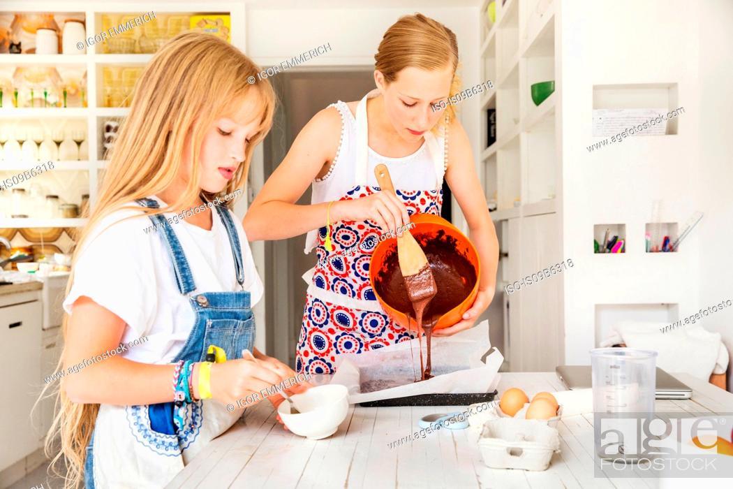 Stock Photo: Girls preparing chocolate brownies in kitchen.