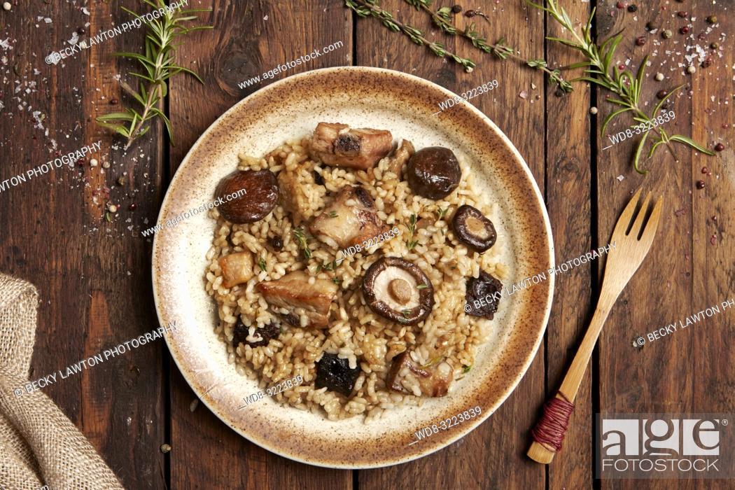 Photo de stock: risotto de carne y setas en plato / meat and mushrooms risotto.
