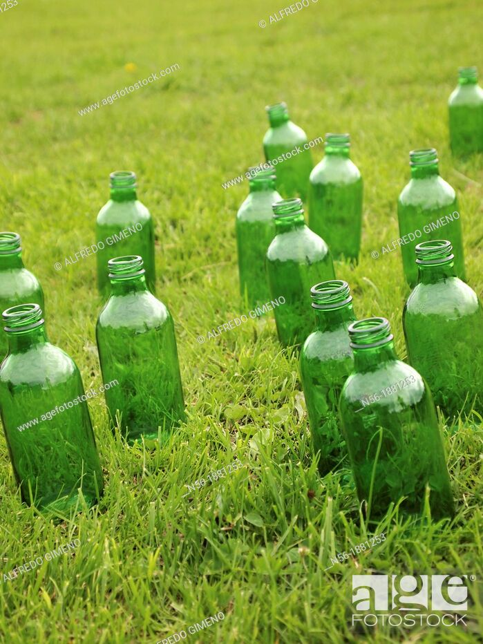 Stock Photo: Green bottles over the grass.