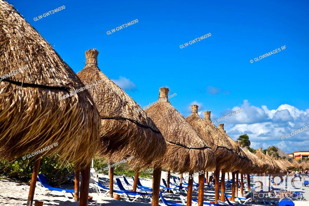 Stock Photo: Palapas and lounge chairs on the beach, Tulum, Quintan Roo, Mexico.