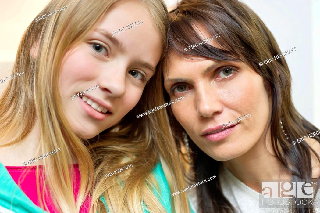 Stock Photo: Portrait of mother and daughter smiling.