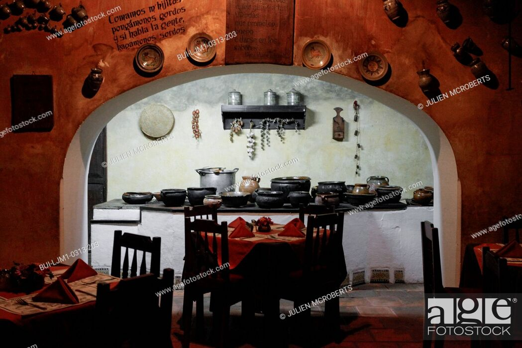 Imagen: View of kitchen with seating arrangement in a restaurant at Antigua; Guatemala.