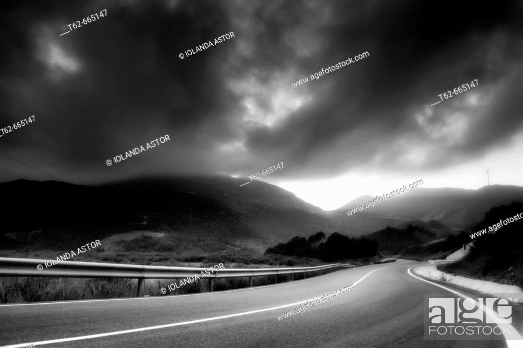 Stock Photo: Empty road under storm clouds. El Priorat, Tarragona province, Catalonia, Spain.