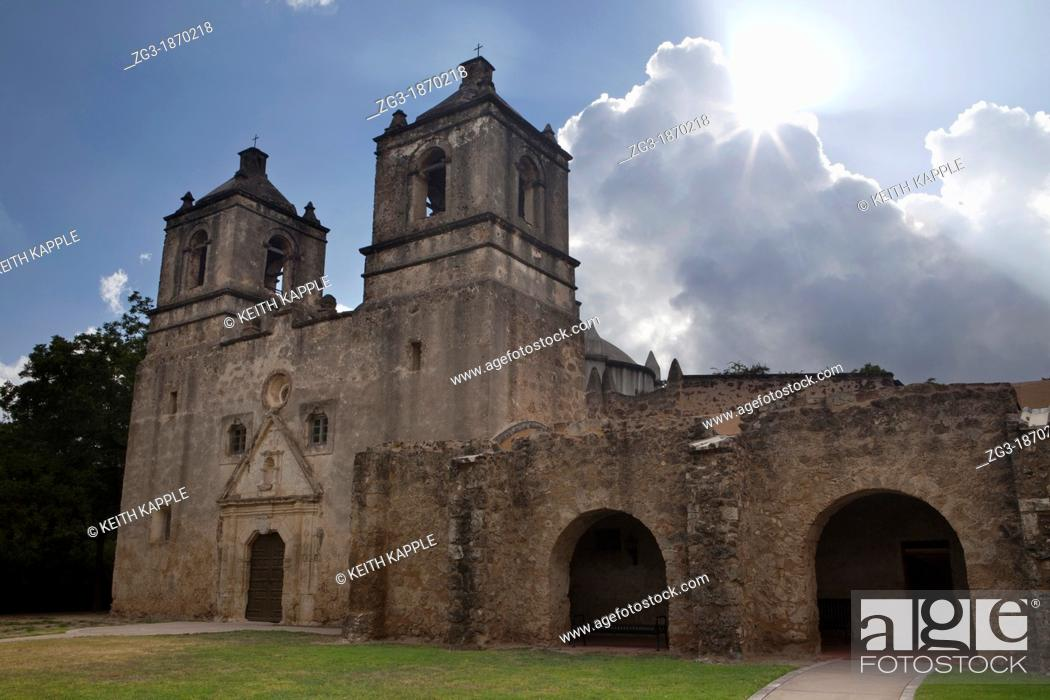 Stock Photo: Sunbeam from behind storm clouds behind Mission Concepcion  Missions National Historical Park , San Antonio, Texas.