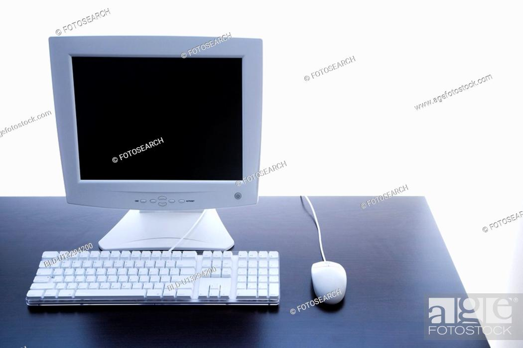 Stock Photo: Still life of computer monitor, keyboard and mouse.