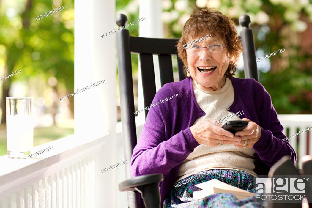 Stock Photo: Senior woman using cellphone.