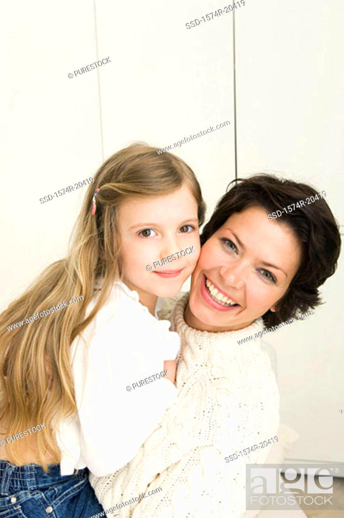 Stock Photo: Portrait of a young woman smiling with her daughter.