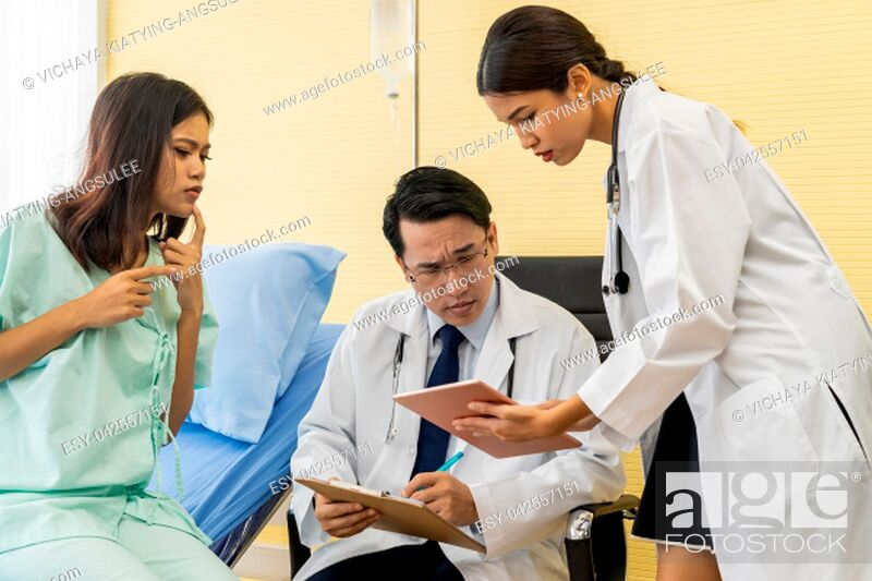 Stock Photo: Patient fell worried while doctors explain about her health situation.