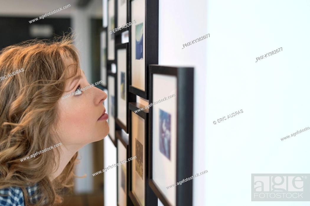 Stock Photo: Interior designer looking at a painting.