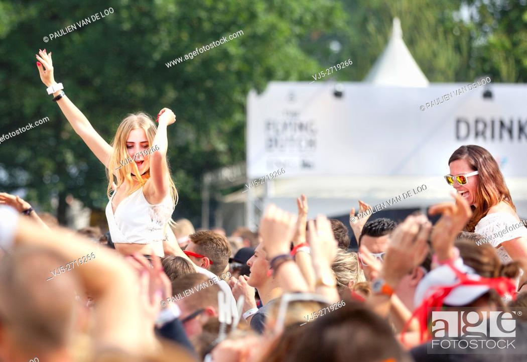 Stock Photo: Eersel, Eindhoven, Netherlands, girls having fun and cheering at an event.