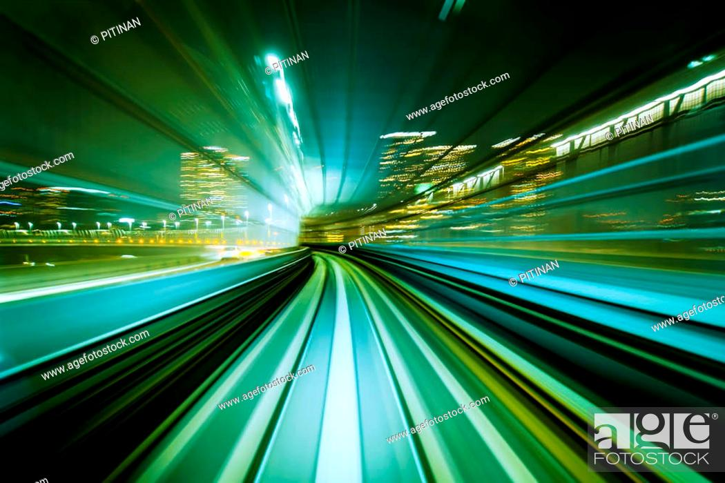 Stock Photo: Motion blurred front view of train running in modern city tunnel. Abstract transportation background.
