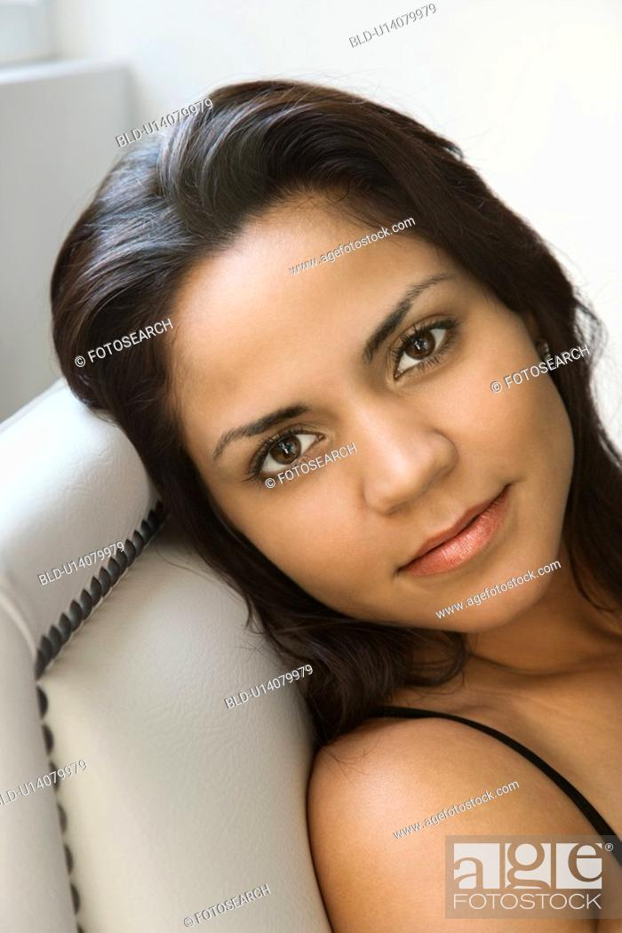 Stock Photo: Head shot of woman looking at viewer.