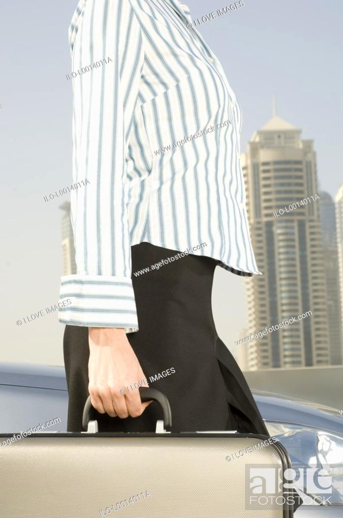 Stock Photo: A businesswoman carrying a briefcase.