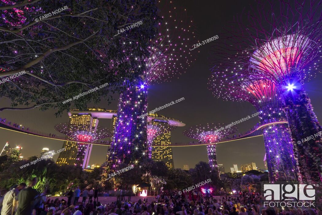 Stock Photo: Singapore, Singapore - October 16, 2018: Supetree Grove and Marina Bay Sands at night at the Gardens by the Bay in Singapore.