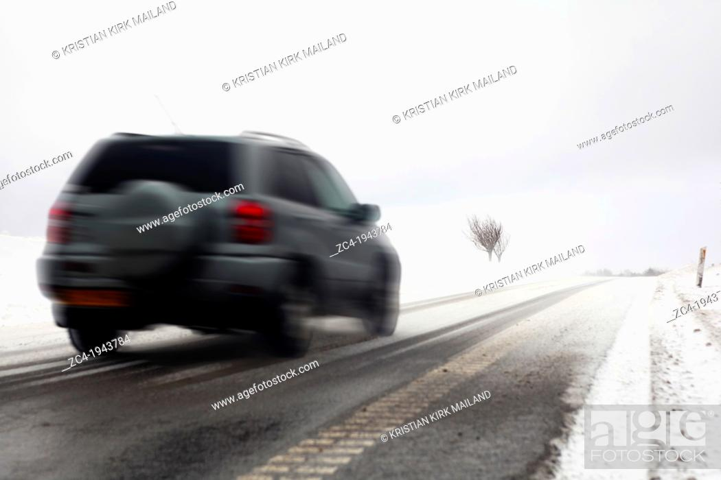Stock Photo: Fast car on snowy winter road.