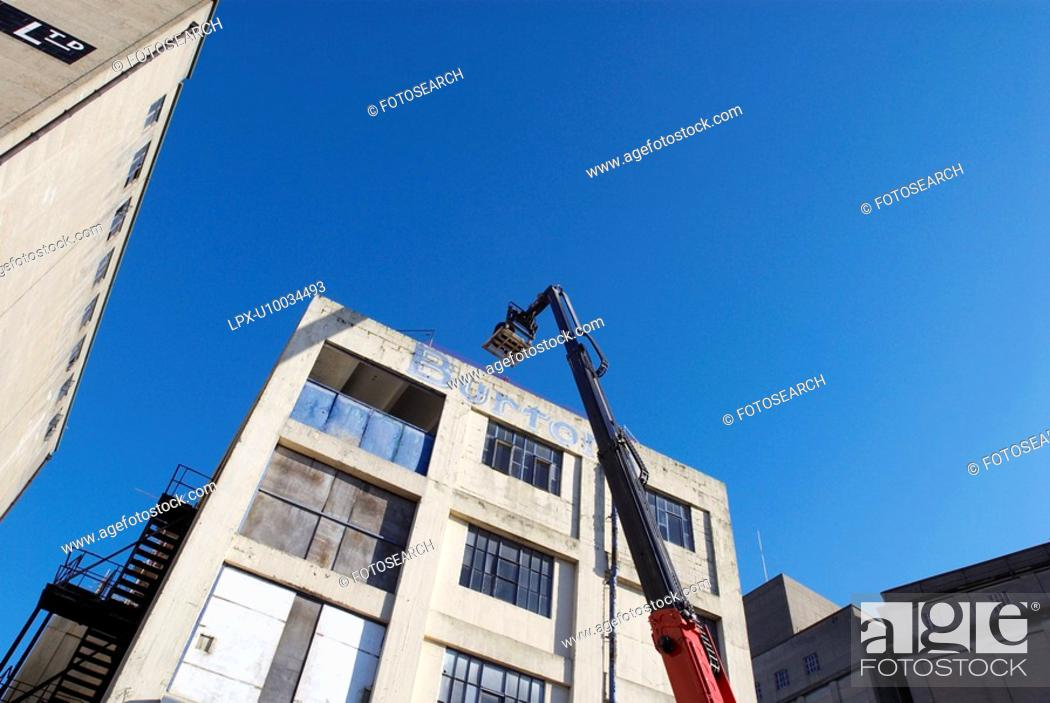 Stock Photo: Forklift with heavy load operated with remote control.