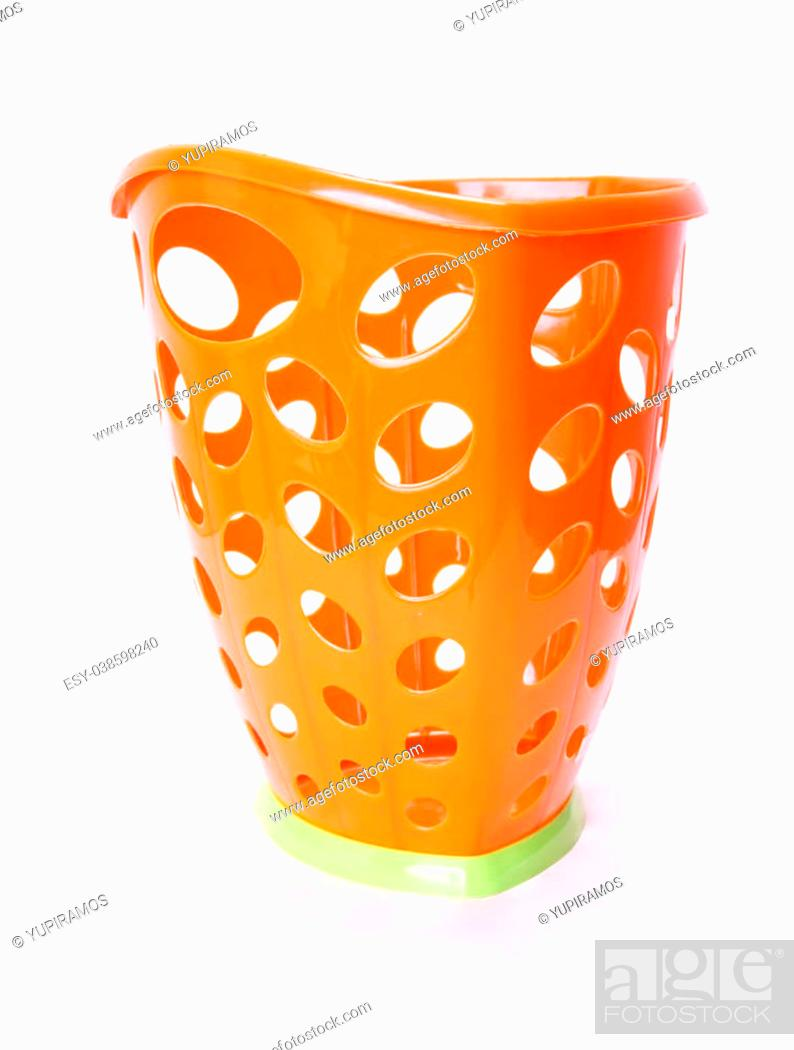 Stock Photo: orange plastic trash can isolated, white background. photography.