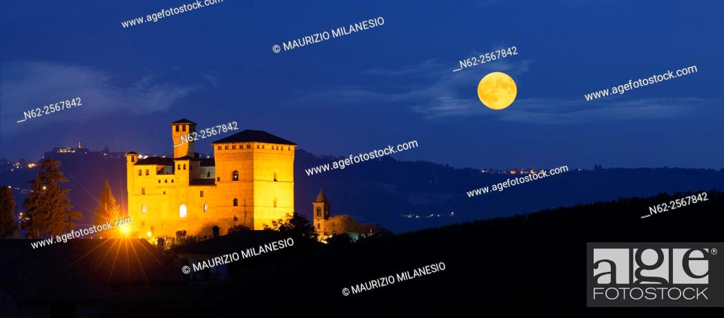 Stock Photo: View in the night with a full moon on the Castle of Grinzane Cavour Unesco heritage in the territory of the Langhe Piedmont Italy.