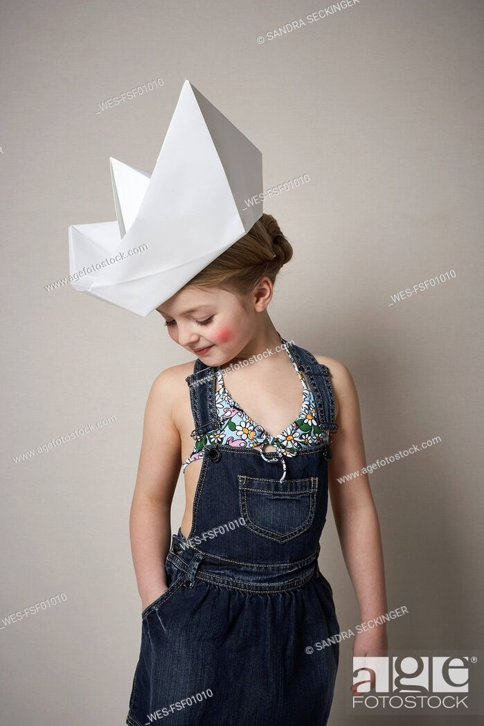 Stock Photo: Little girl wearing big paper boat.