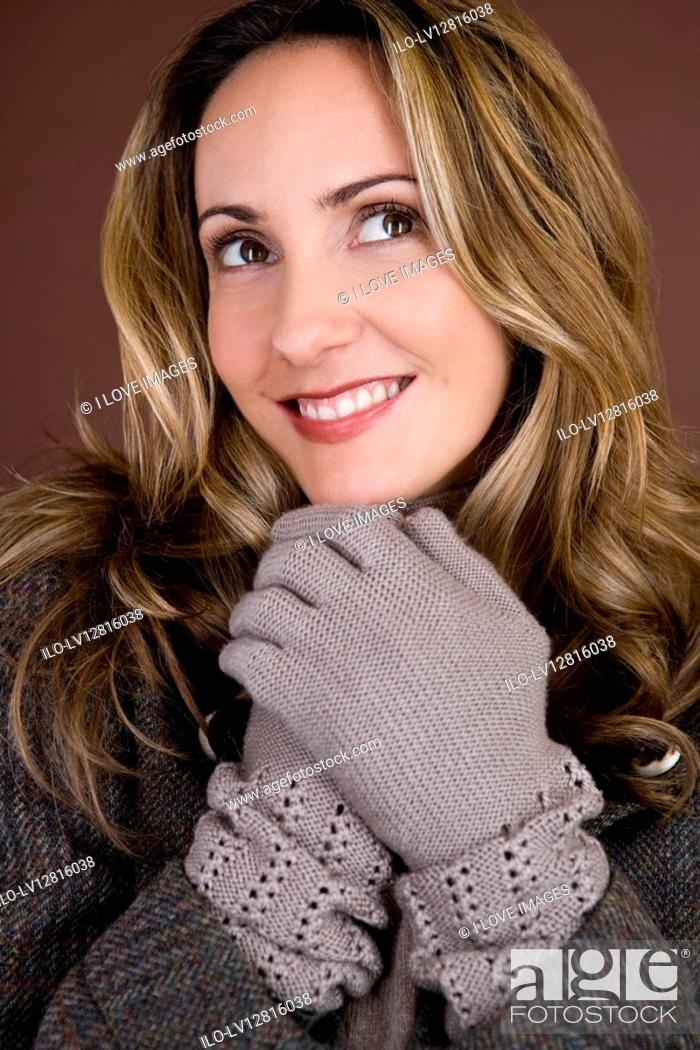 Stock Photo: Portrait of a mid adult woman wearing autumnal clothes.