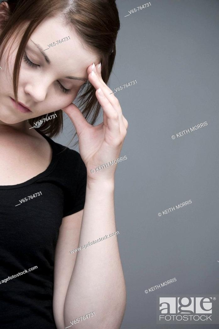 Photo de stock: moody teenage girl looking sad and depressed.