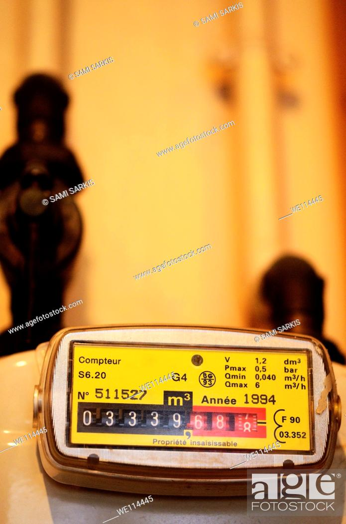 Stock Photo: Gas meter in kitchen, close-up, France.