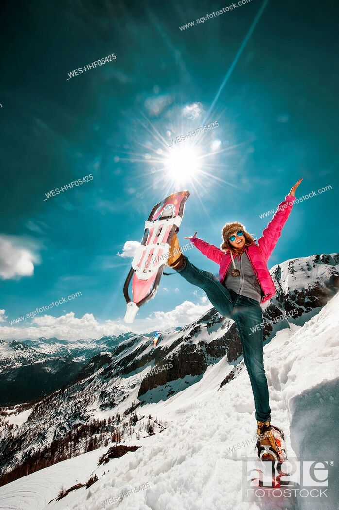 Stock Photo: Austria, Salzburg County, Young woman snowshoeing in the mountains.