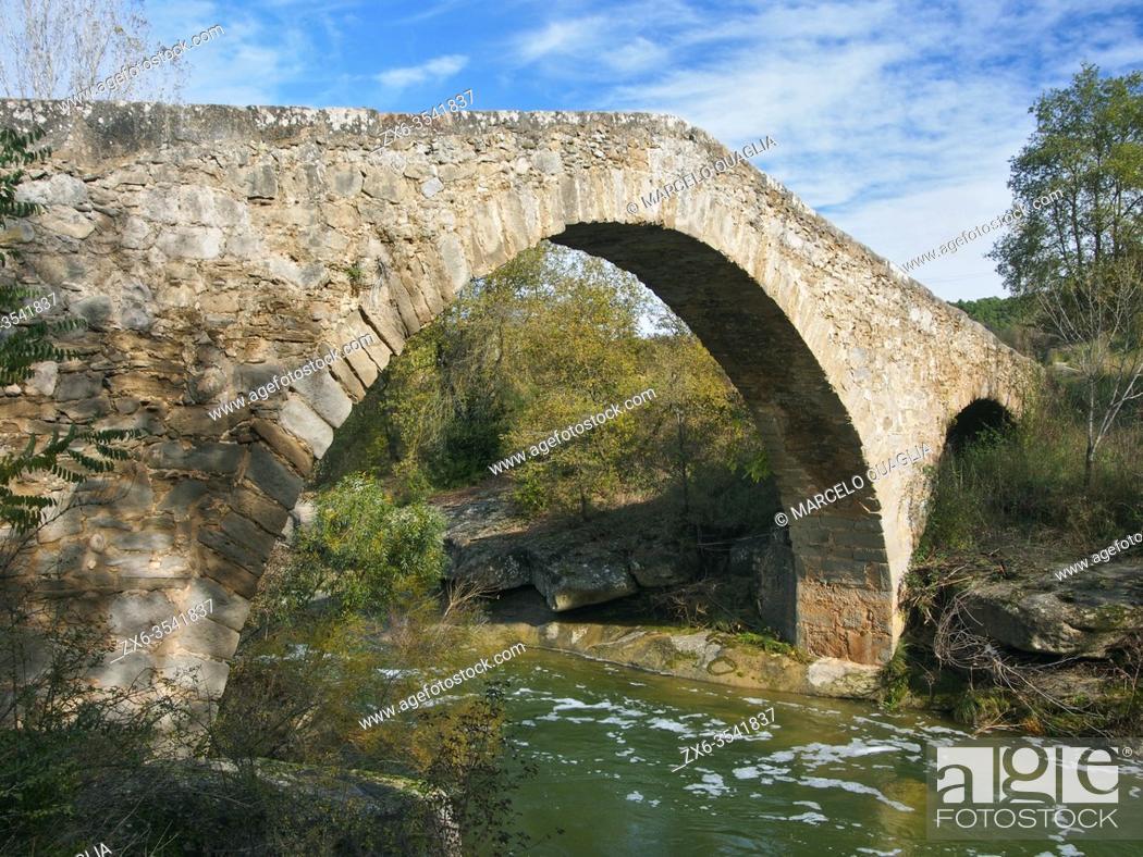Stock Photo: Medieval stone bridge over Merlés stream. Santa María de Merlés village countryside. Lluçanès region, Barcelona province, Catalonia, Spain.