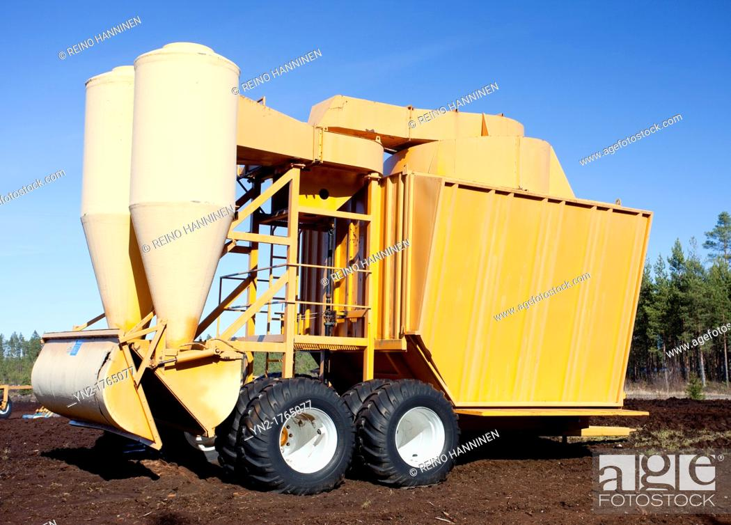 Stock Photo: Mobile pneumatic sucking peat harvester / loader JIK-40DF trailer is used when peat is harvested from a peat bog  Location Multaharjunsuo Rautalampi Finland.